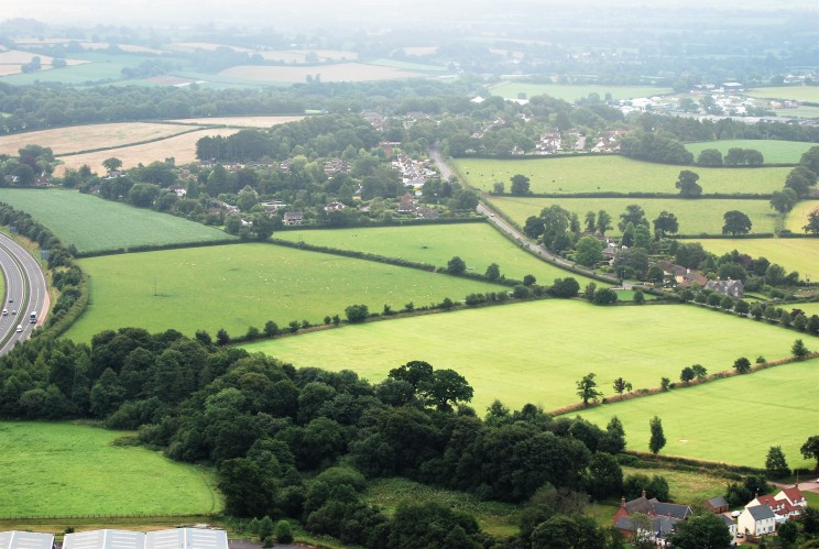 East Tiverton from the west, 2004. The TEUE covers most ot the greenfield sites shown, all of which are planned for future development.